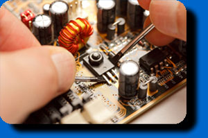 technician working on printed circuit board