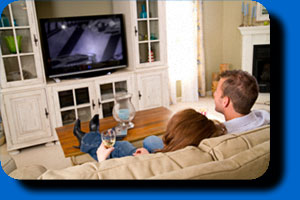 Couple watching flatscreen television